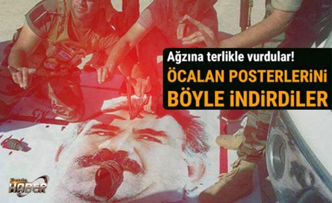 TÜRKMENLER PKK'NIN BAYRAK VE POSTERLERİNİ İNDİRDİ
